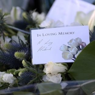 Thurrock Gazette: Flowers left on behalf of Ann Maguire's husband Donald outside Corpus Christi Catholic College