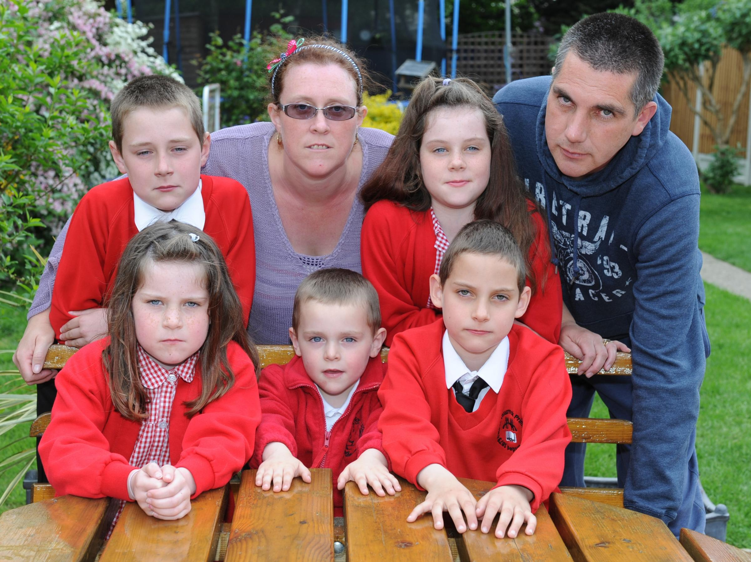Vanessa Simmonds with son Harrison 4 who can't go to same school as brothers and sisters. 7 Moore ave, Grays PIC- back row l-r Ryan 10, mum Vanessa, Bethany 9, dad Dave, front Emma 6, Harrison 4 and Daniel 9