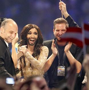 Thurrock Gazette: Austria's Conchita Wurst, who performed the song Rise Like a Phoenix, listens as points are announced at the final of the Eurovision Song Contest in Denmark (AP)