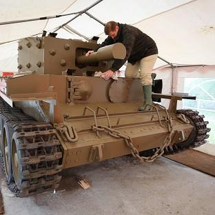 Thurrock Gazette: Nicolas Dumont works on a centaur tank which has been restored after lying abandoned on the banks of the Caen Canal near Pegasus Bridge since the Normandy Landings