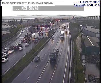 Delays building on M25 after crash on QEII Bridge