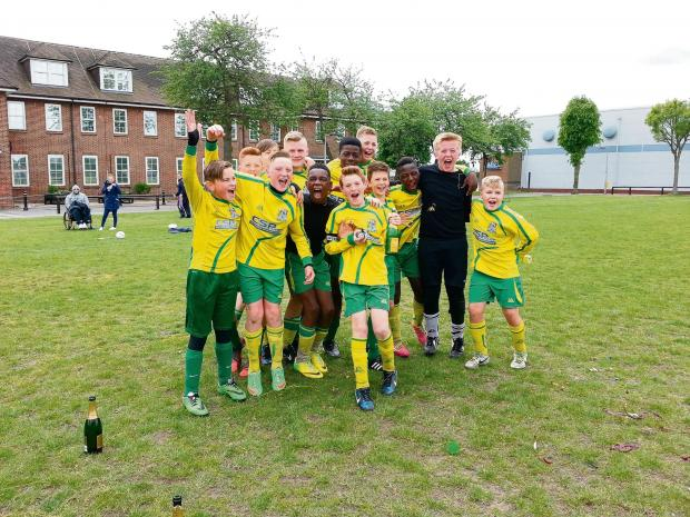 Celebration time for Thurrock Youth Greens who won their league