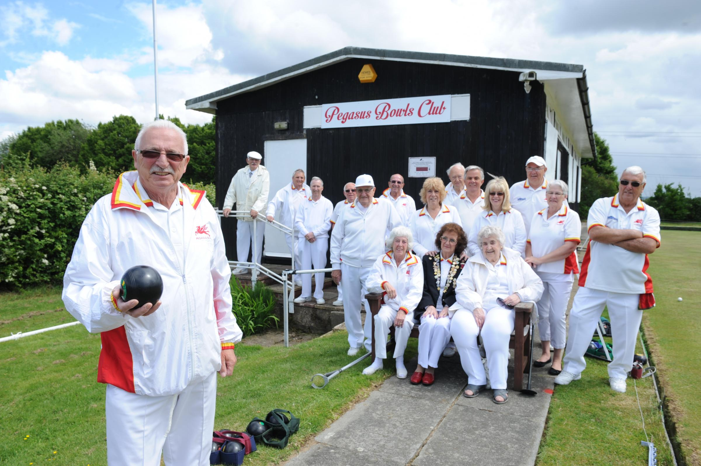 Club captain George Martin, front left, with the Pegasus Bowls Club