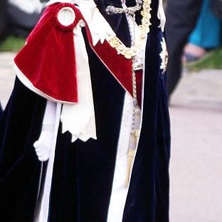 The Queen makes her way to St George's Chapel in the grounds of Windsor Castle for the annual Order of the Garter service