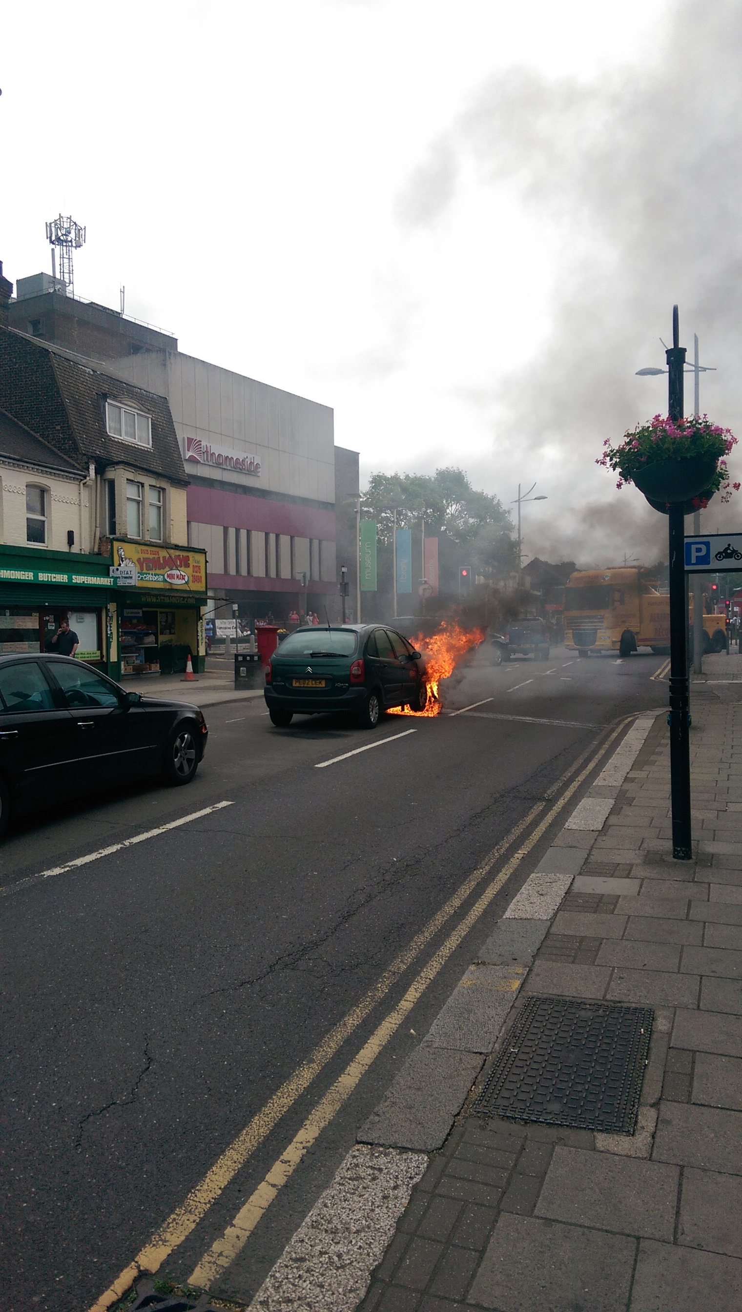 Car fire closes town centre road