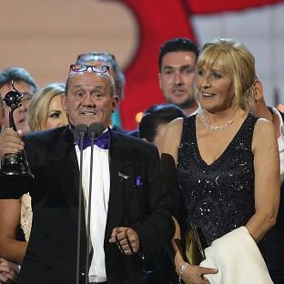Brendan O'Carroll and the cast of Mrs Brown's Boys accept the award for Best Comedy at the 2014 National Television Awards