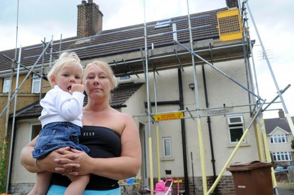 Dawn West has had scaffolding outside her home for two months after it was erected by the council but no work has yet been done