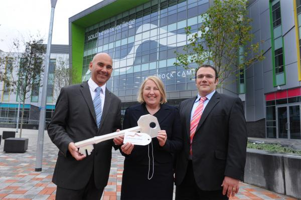 Angela O'Donoghue, (centre) the college's principal and chief executive and her deputy Anthony McGarel (right) received the symbolic key from Steve Arthrell (left), the project director for the campus construction firm Skanska.