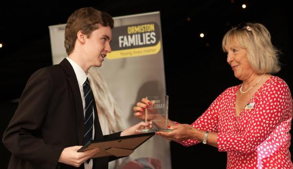 Rhys McArdle receiving his award from Dianne Murray