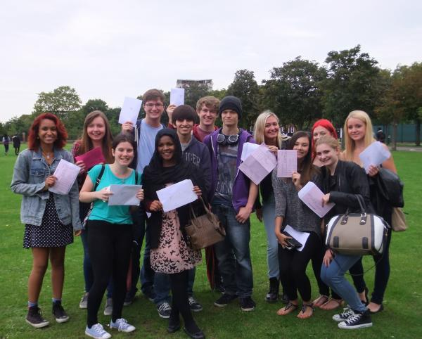 All smiles - pupils at Palmer's College this morning after collecting their results