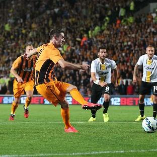 Robbie Brady, second from left, scores Hull's second goal from the penalty spot