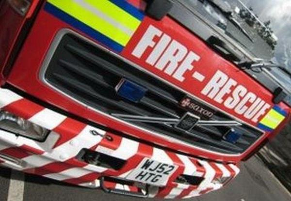 Firefighters tackle fire at garden outbuilding