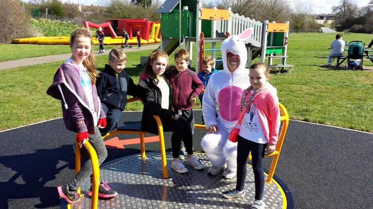 Children enjoy the new roundabout with Shane Ralph (dressed as a rabbit) of Friends of Hardie Park