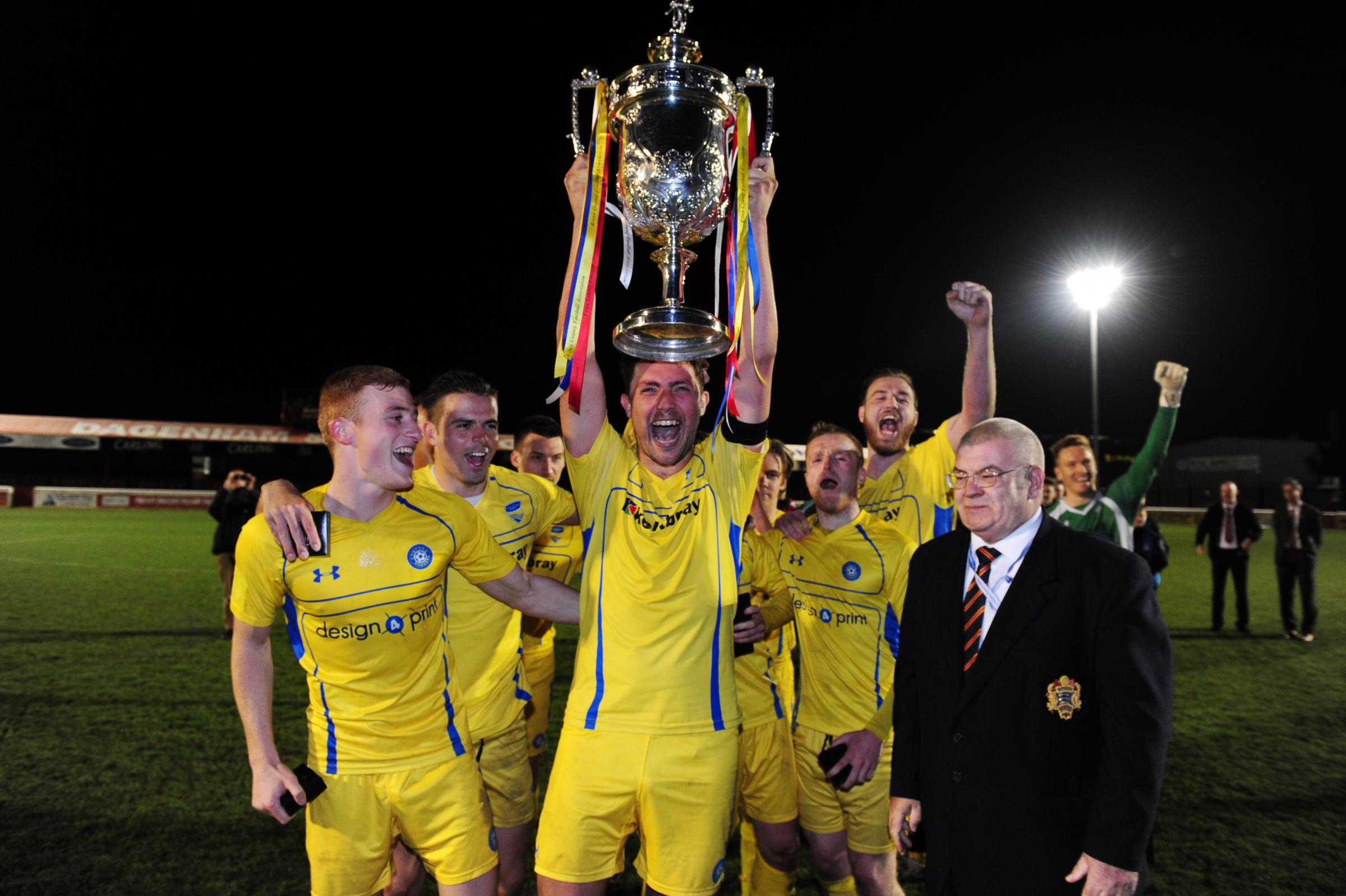 Winners - Concord win the trophy in 2016. James White, pictured, lifting the trophy, now plays for East Thurrock