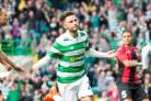 Celtic winger Patrick Roberts, pictured centre, is desperate to play Champions League football