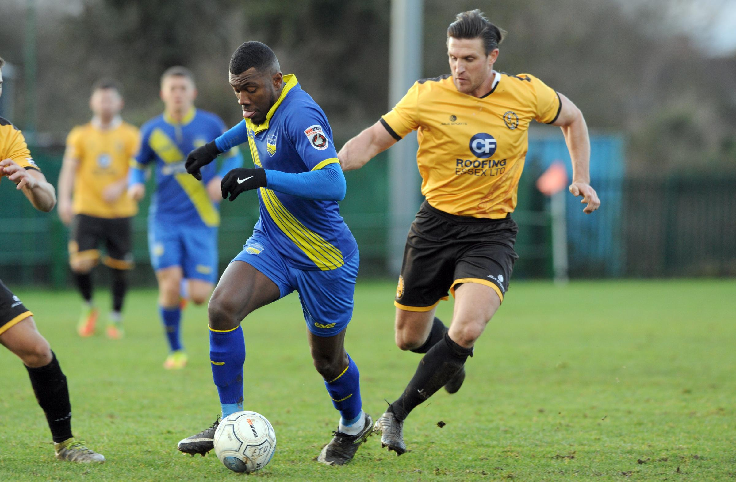 On the charge - Lee Burns closes down Concord Rangers' Femi Akinwande in a recent league match