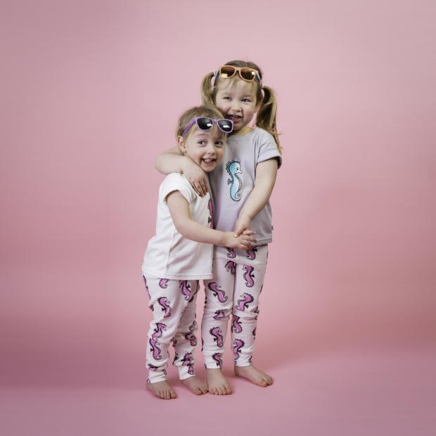 Thurrock Gazette: Family - Emma's daughter Immy and Sarah's little girl Olivia model some of their designs