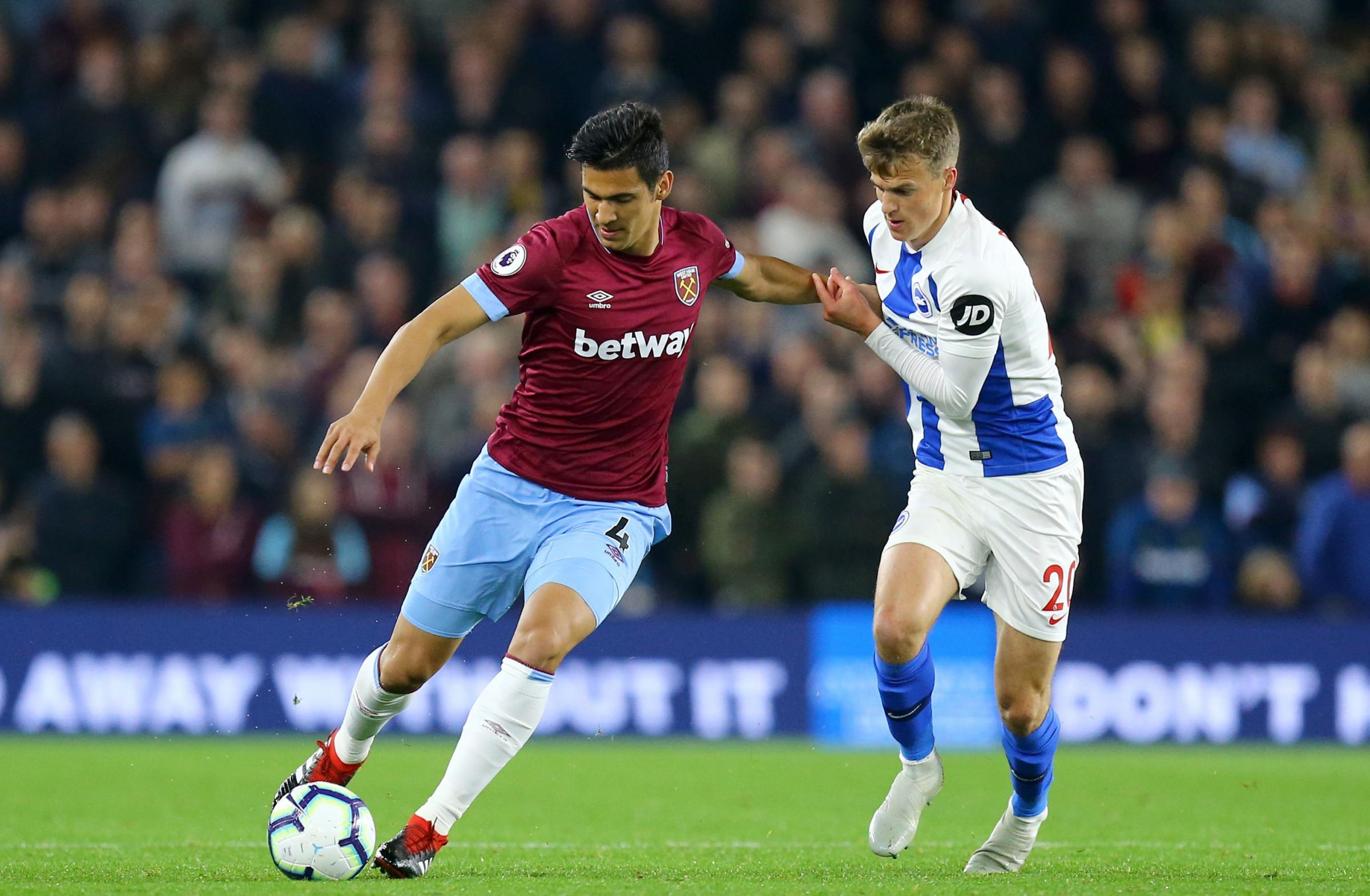 West Ham United's Fabian Balbuena (left) and Brighton & Hove Albion's Solly March battle for the ball during the Premier League match at the AMEX Stadium, Brighton. PRESS ASSOCIATION Photo. Picture date: Friday October 5, 2018. See PA story SO