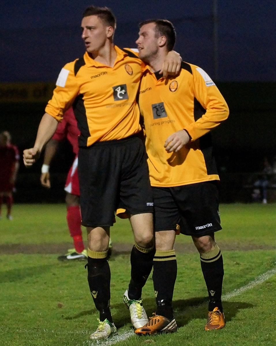 Back in yellow - Steve Sheehan, left, with Rocks skipper Sam Higgins in 2013
