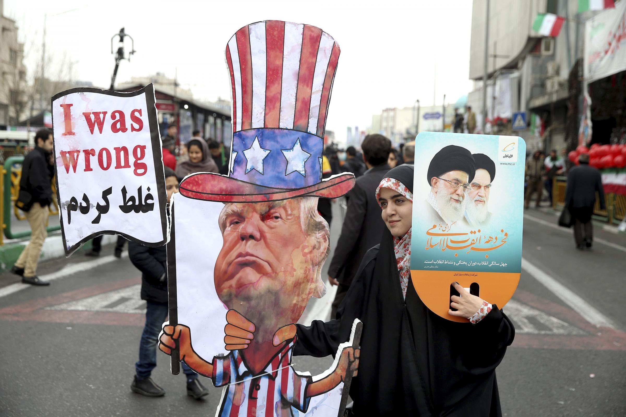 An Iranian woman holds an effigy of US president Donald Trump during anniversary celebrations