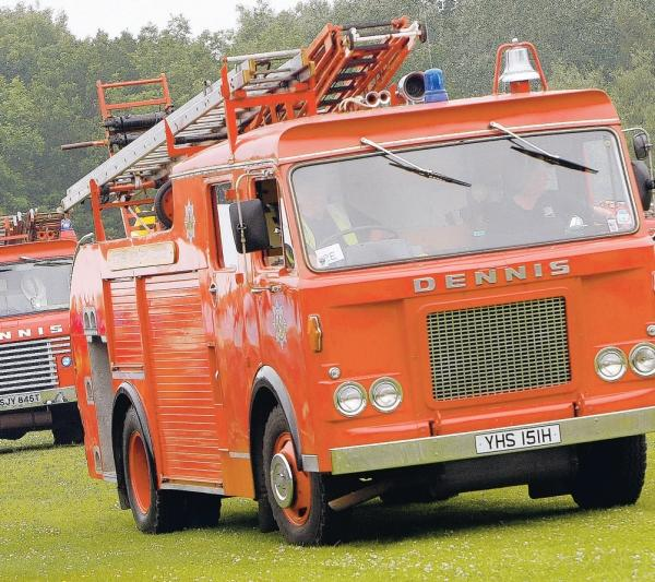 Vintage vehicles, like this fire engine, will be part of the procession